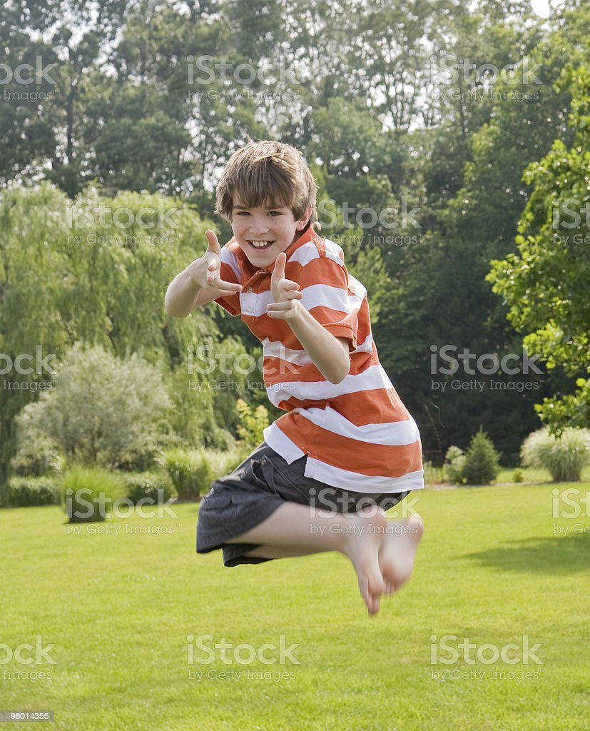 Boy Jumping in the Air royalty-free stock photo