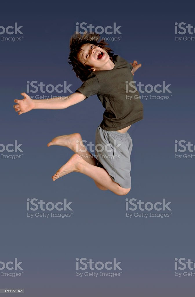 Boy jumping in the air with bare feet stok fotoğrafı
