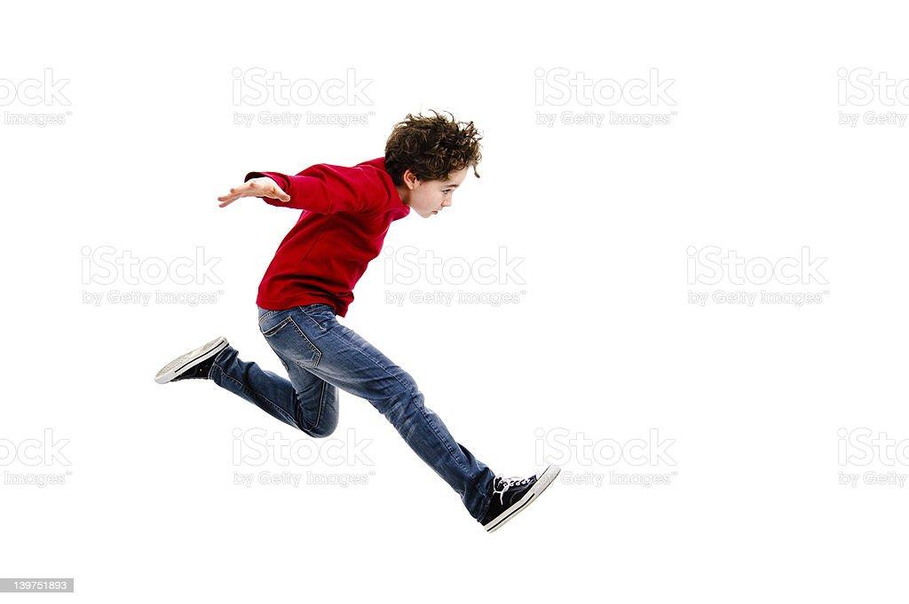 Boy jumping isolated on white background stock photo