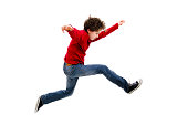 istock Boy jumping isolated on white background 483559071
