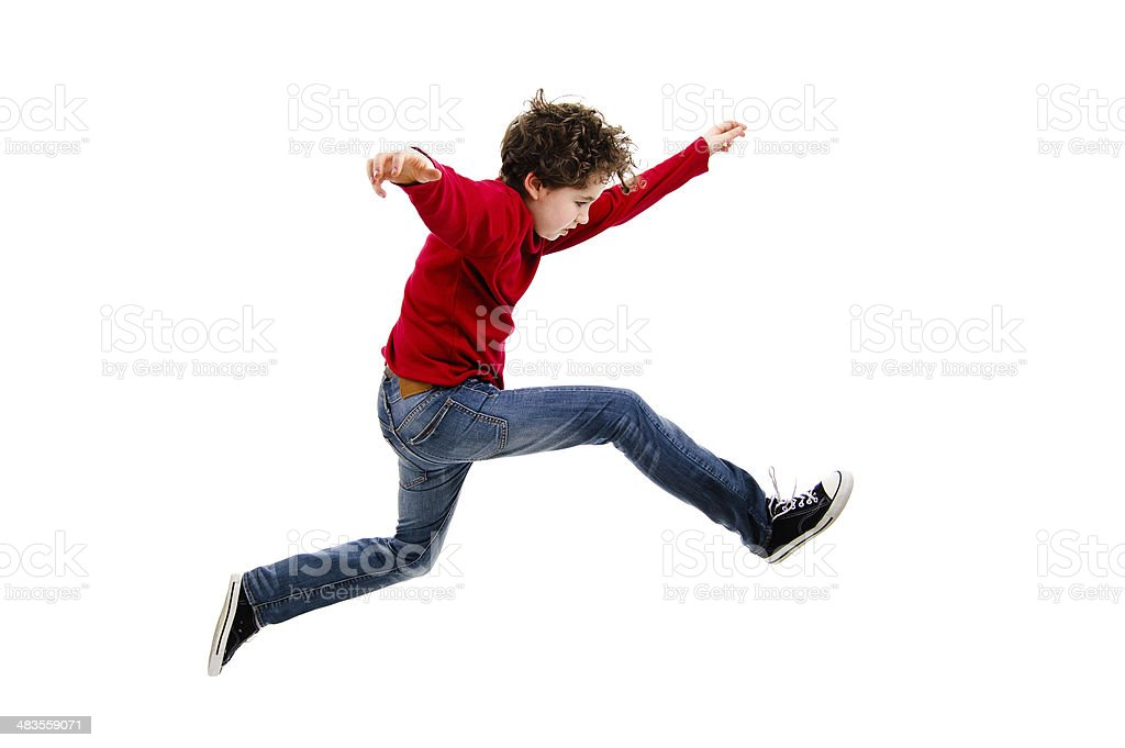 Garçon sautant isolé sur fond blanc - Photo
