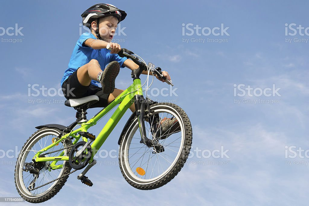 Boy jumping on bike royalty-free stock photo