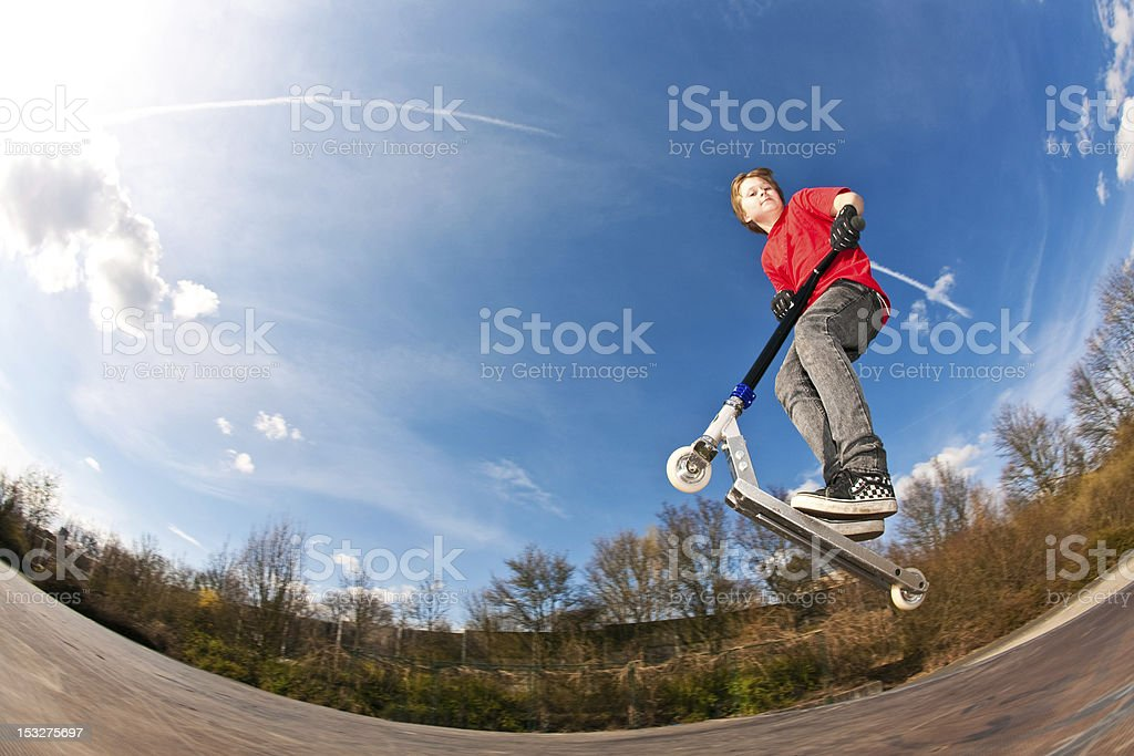 boy jumping with a scooter royalty-free stock photo