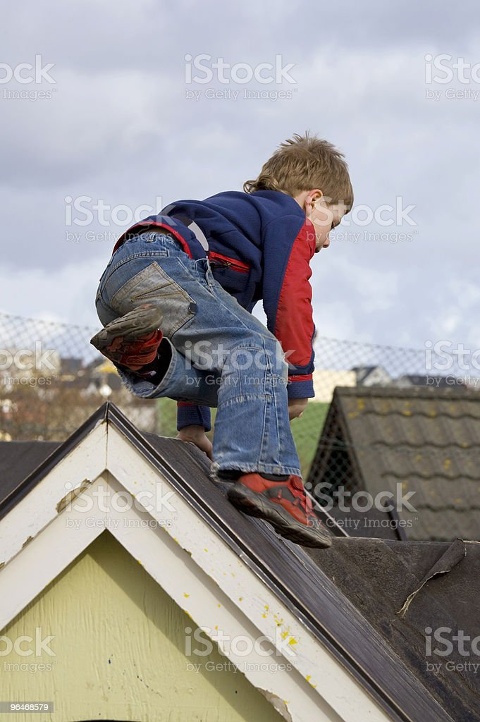 Boy jumps through the roof royalty-free stock photo
