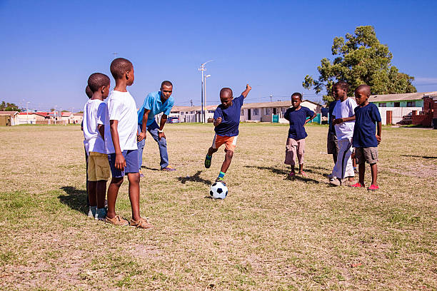 Boy kicking a penalty, Gugulethu, Cape Town, South Africa foto