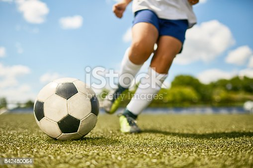 istock Boy Kicking Ball 842480064