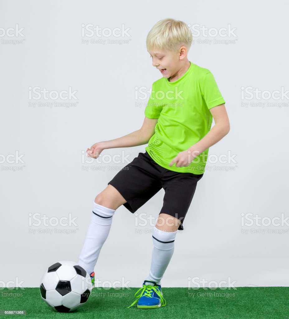 boy kicking soccer ball stock photo more pictures of 8 9 years