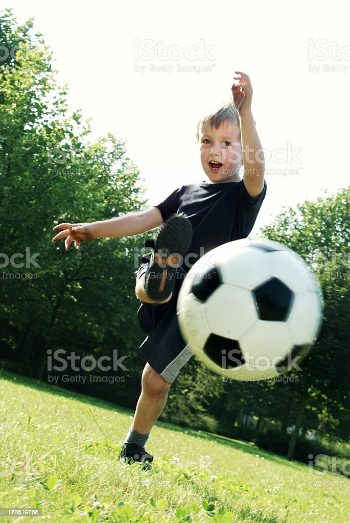Boy kicking the ball! royalty-free stock photo