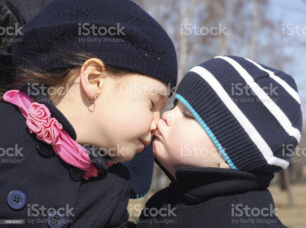 Boy kisses sister stock photo