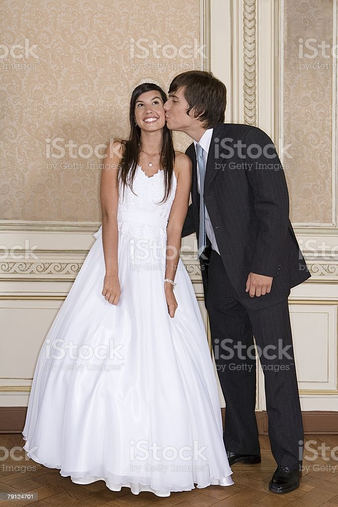 Boy kissing girl at quinceanera royalty-free 스톡 사진