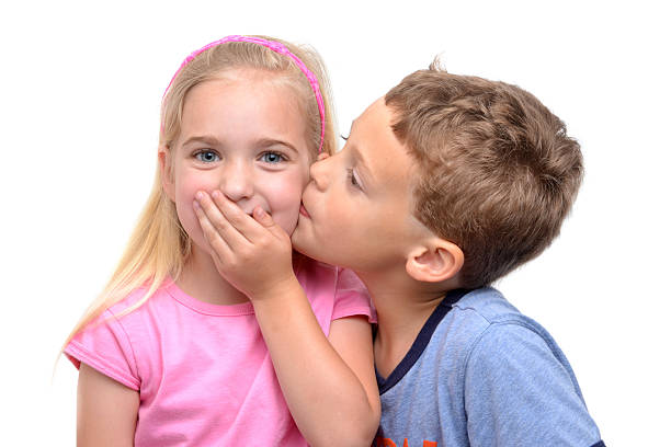 boy kissing girl - little girls little boys kissing love stock photos and pictures