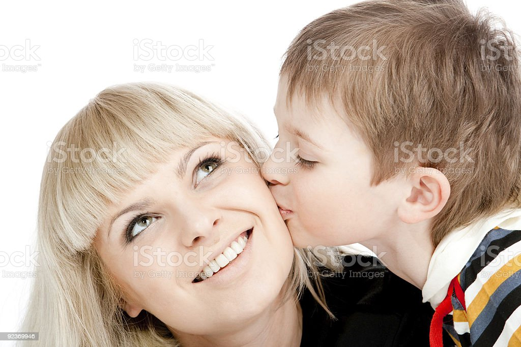 Boy kissing mother royalty-free stock photo