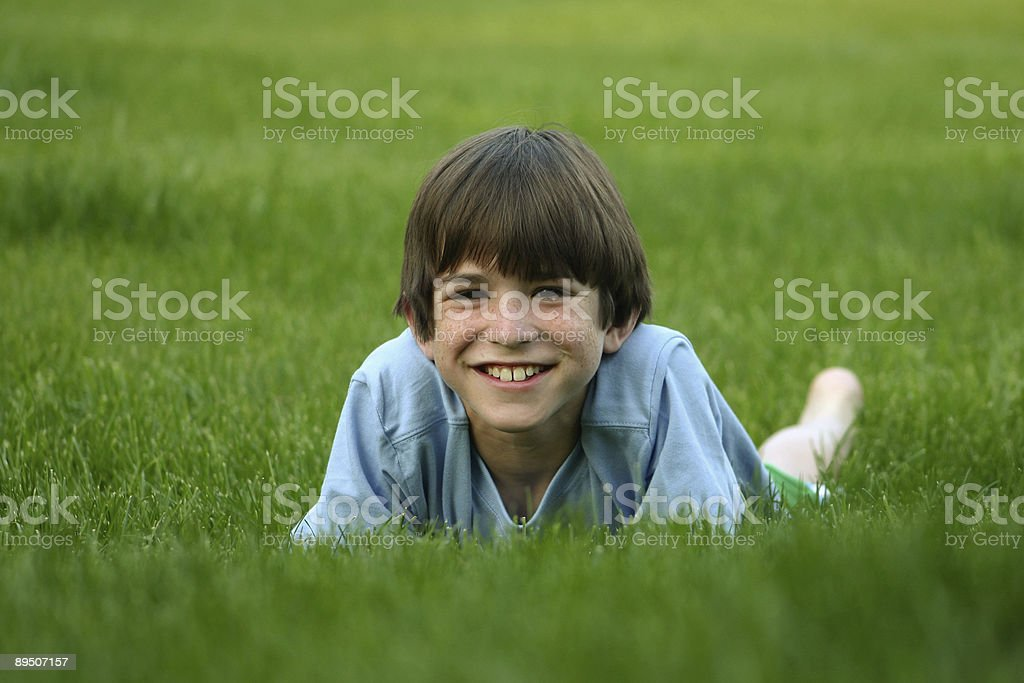 Boy Laying in Grass royalty-free stock photo