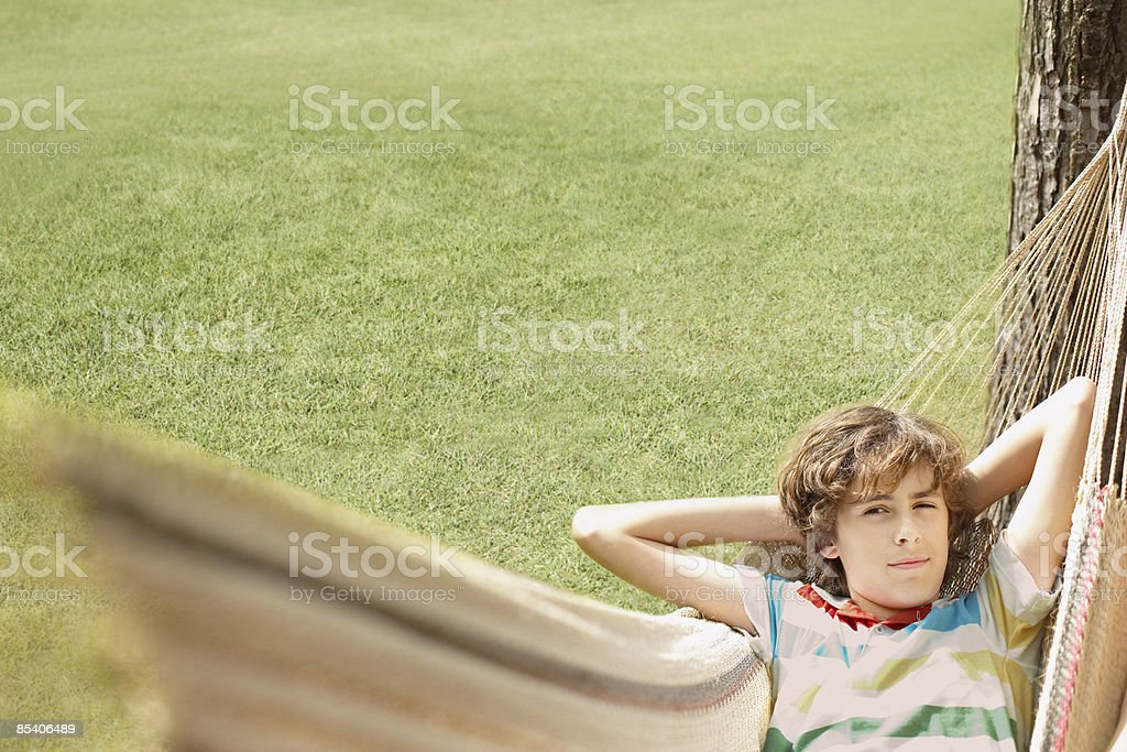 Boy laying in hammock royalty-free stock photo