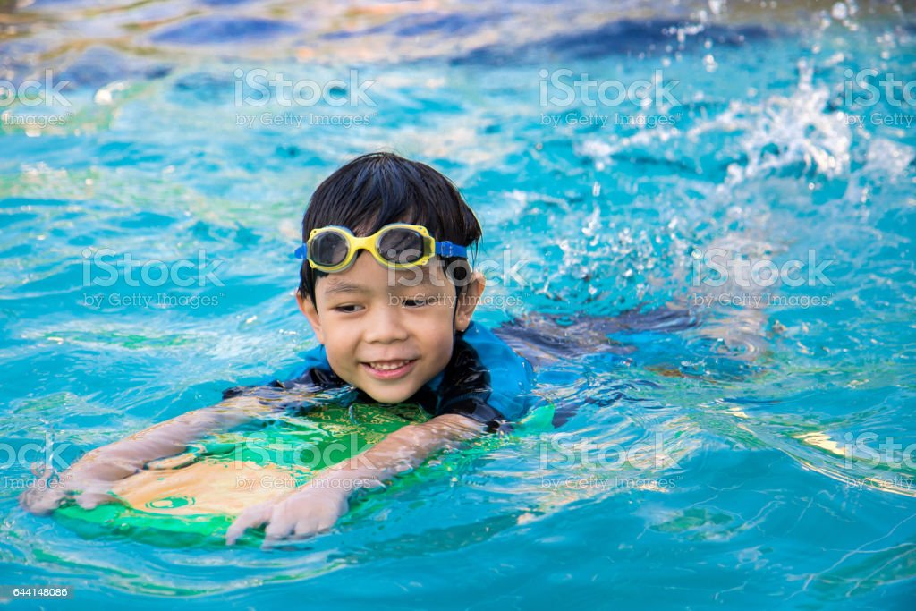 boy learn to swim in the swimming pool stock photo