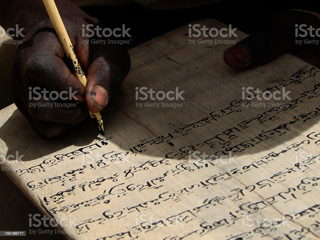 Boy learning a Qur'an Text, Timbuktu stock photo