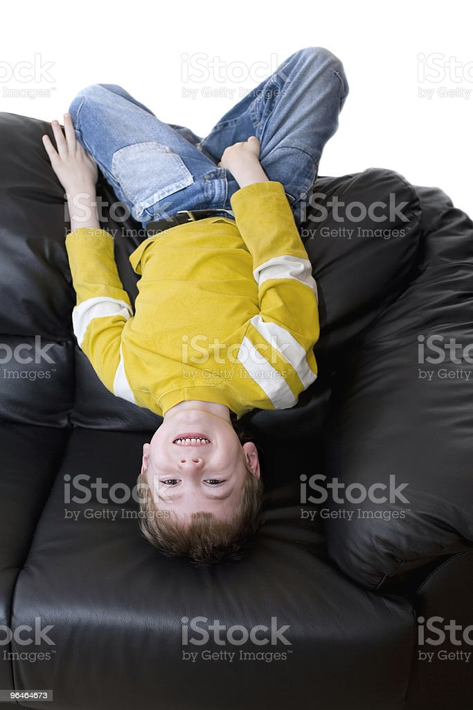 Boy  lies on the couch royalty-free stock photo