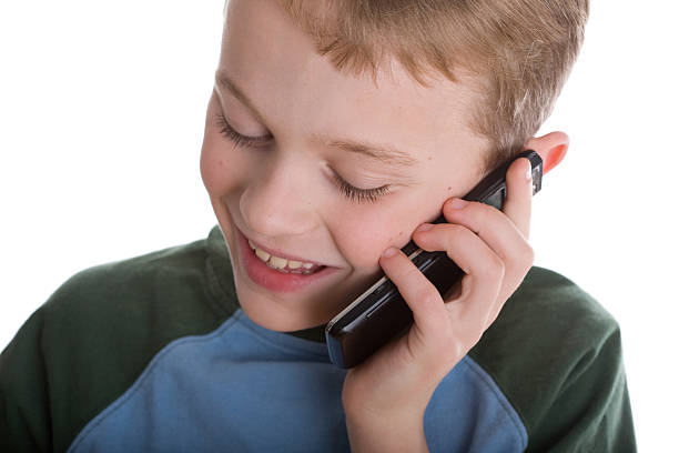 Boy listening to cell call stock photo