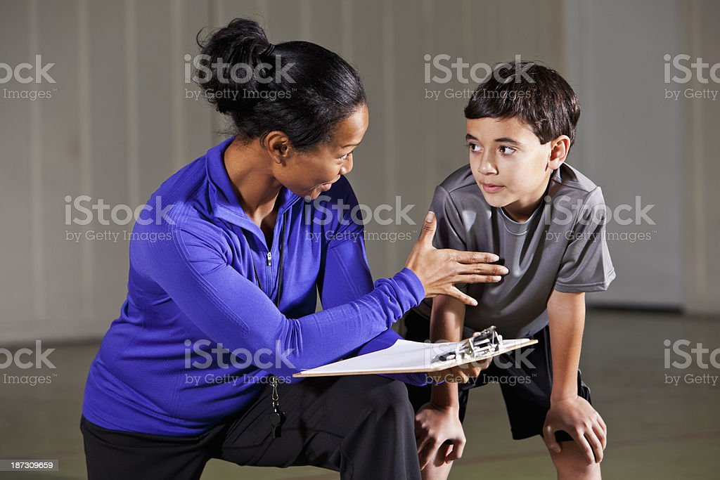 Boy listening to coach royalty-free stock photo