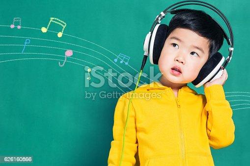 istock Boy Listening to Music Headphones 626160866