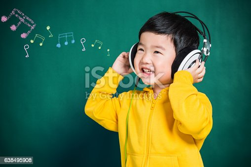 istock Boy Listening to Music Headphones 638495908