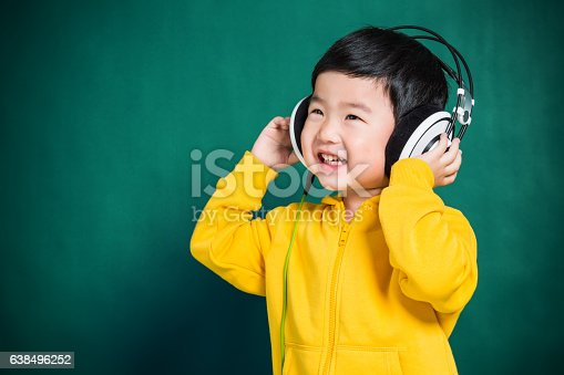 istock Boy Listening to Music Headphones 638496252