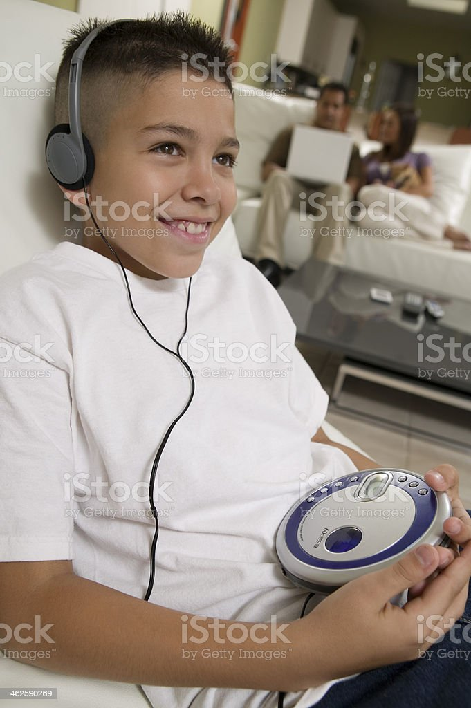 Boy Listening to Music on Portable CD Player stock photo