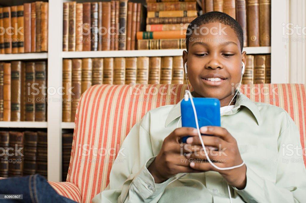 Boy listening to music royalty-free stock photo