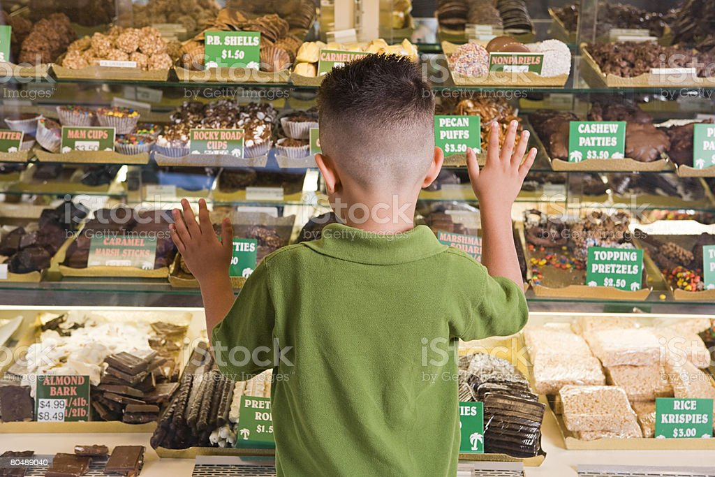 Boy looking at cakes stock photo