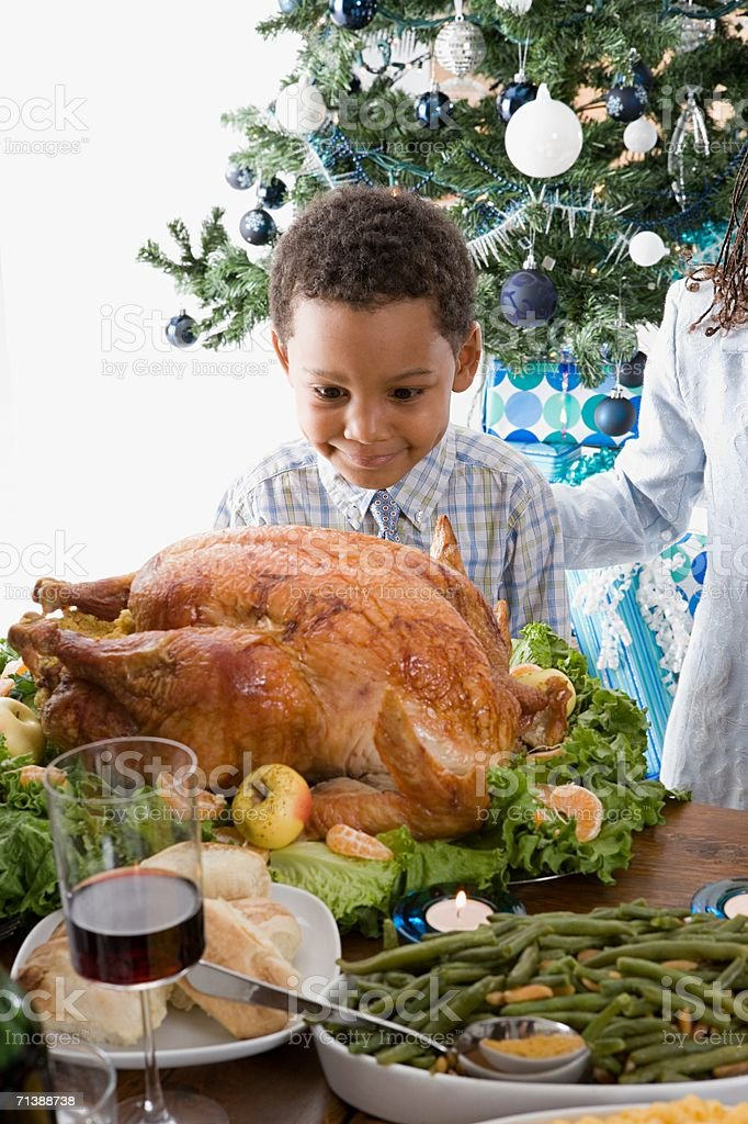 Boy looking at Christmas turkey royalty-free stock photo