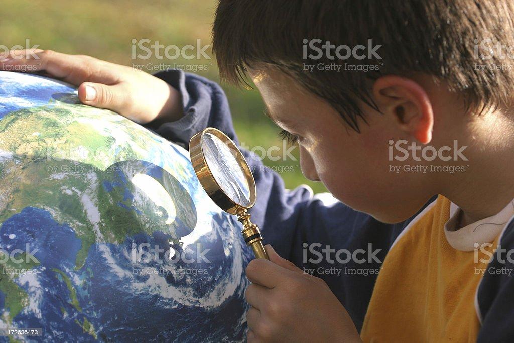 Boy looking at globe royalty-free stock photo