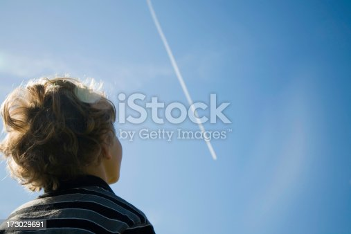 Boy looking at jet smoke