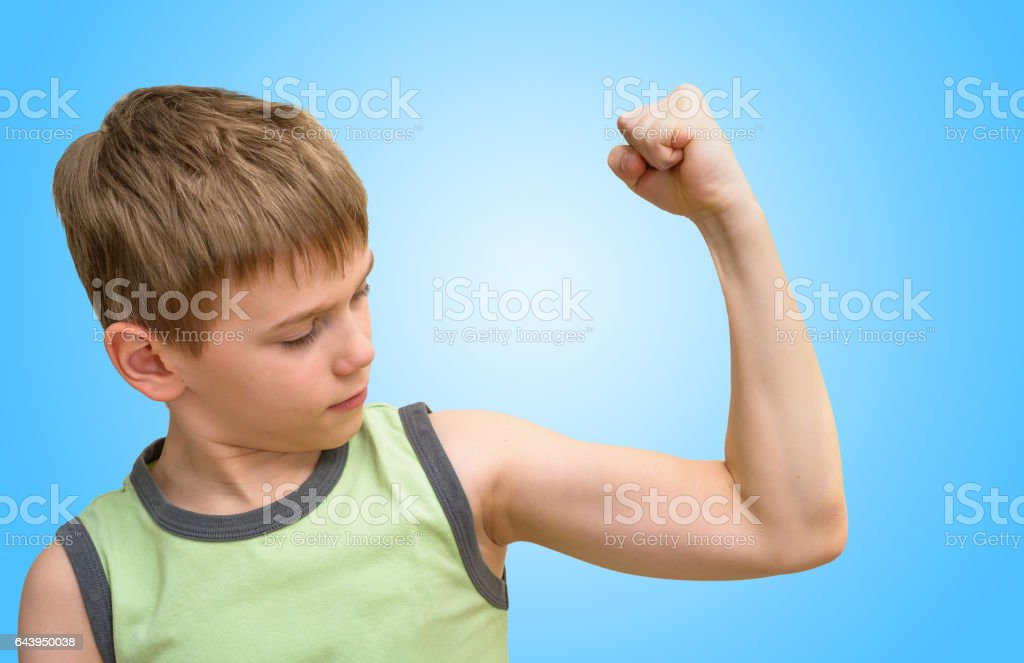 Boy Looking At The Bicep Muscle Stock Photo More Pictures Of Arm