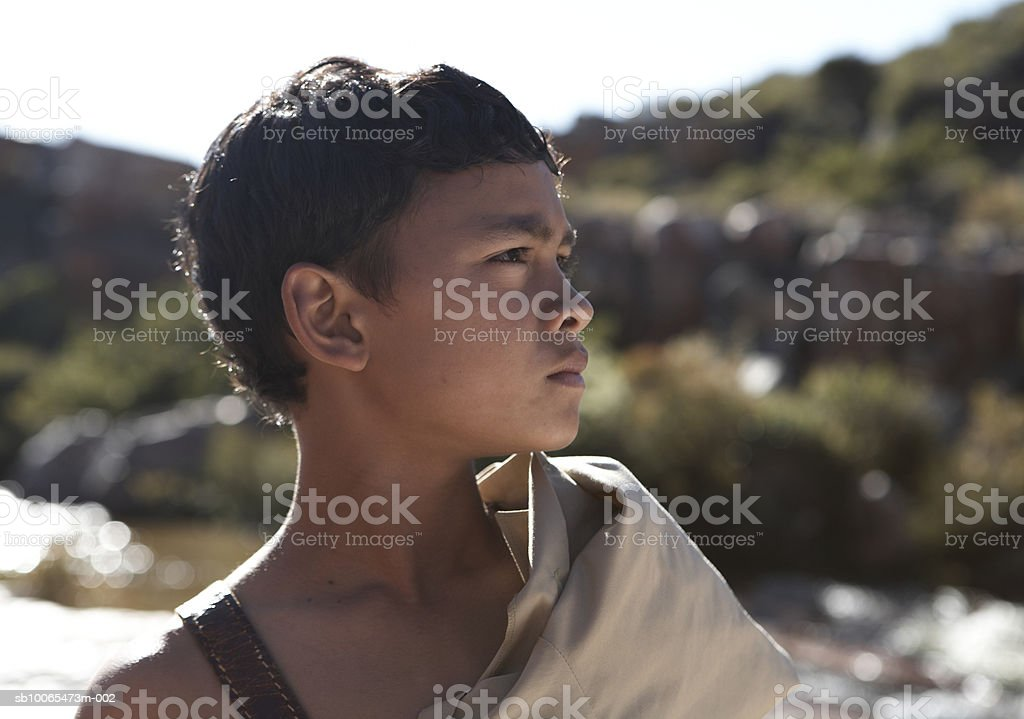 Boy (10-11) looking away, close-up royalty-free stock photo