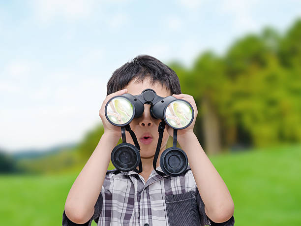 boy looking birds by binoculars - binocular boy bildbanksfoton och bilder
