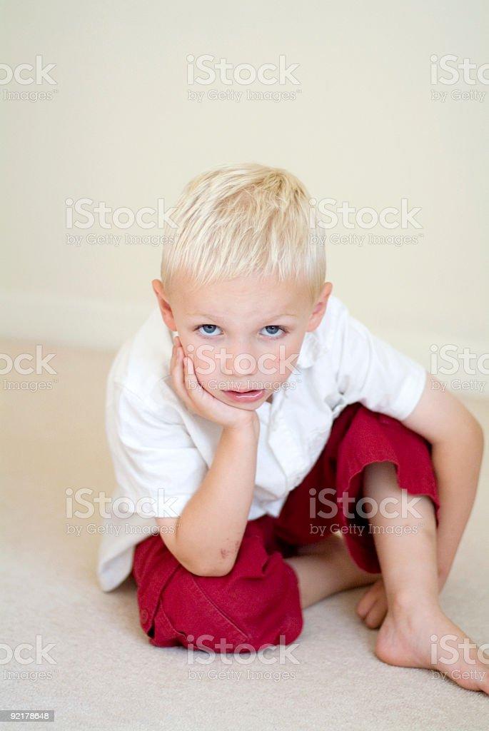 boy looking straight at camera stock photo