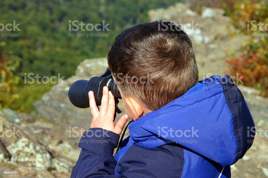 Boy looking through a  binocular royalty-free stock photo