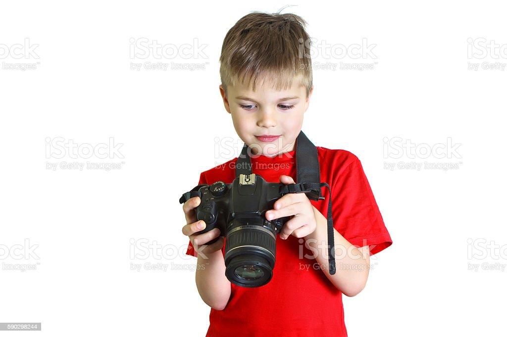 Boy looks at the photo on his camera royaltyfri bildbanksbilder