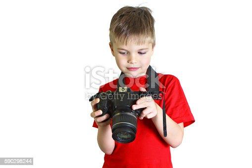 Boy Looks At The Photo On His Camera-foton och fler bilder på Barn