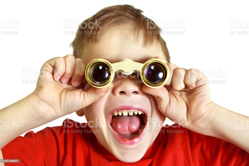 Boy looks through binoculars and shouting royaltyfri bildbanksbilder