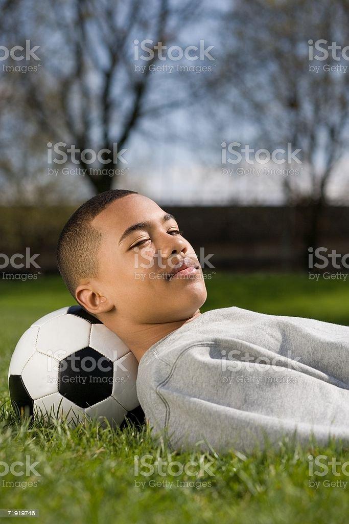 Boy lying down royalty-free stock photo