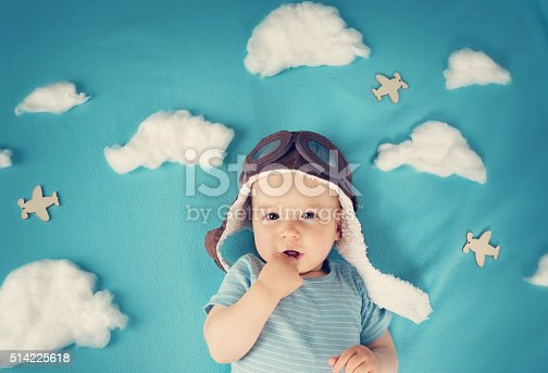 istock boy lying on blanket with white clouds 514225618