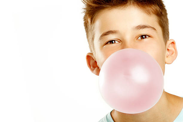 boy make bubble with chew stock photo
