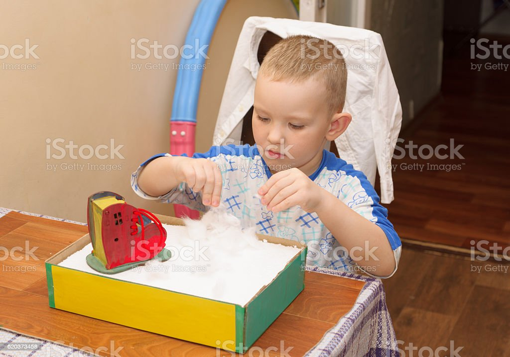 boy makes crafts zbiór zdjęć royalty-free
