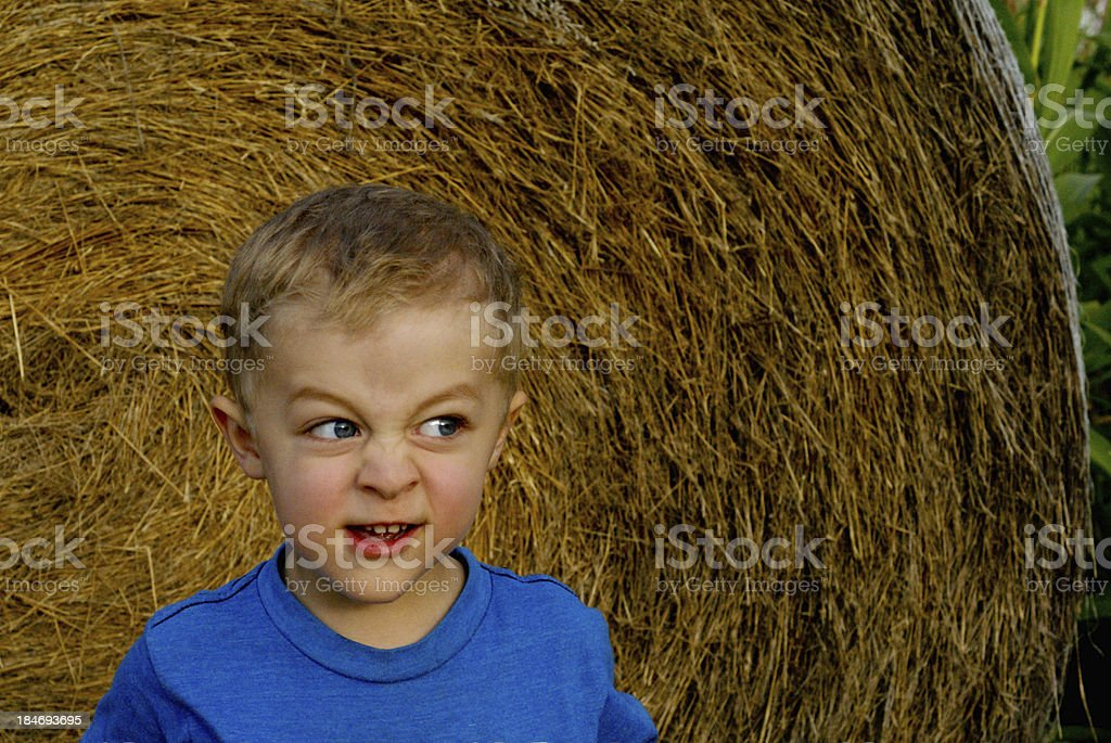 Boy Making a Scary Evil Face stock photo