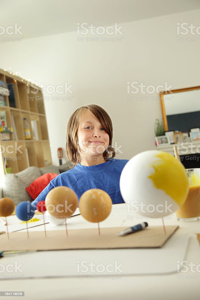 Boy making a Solar System royalty-free stock photo