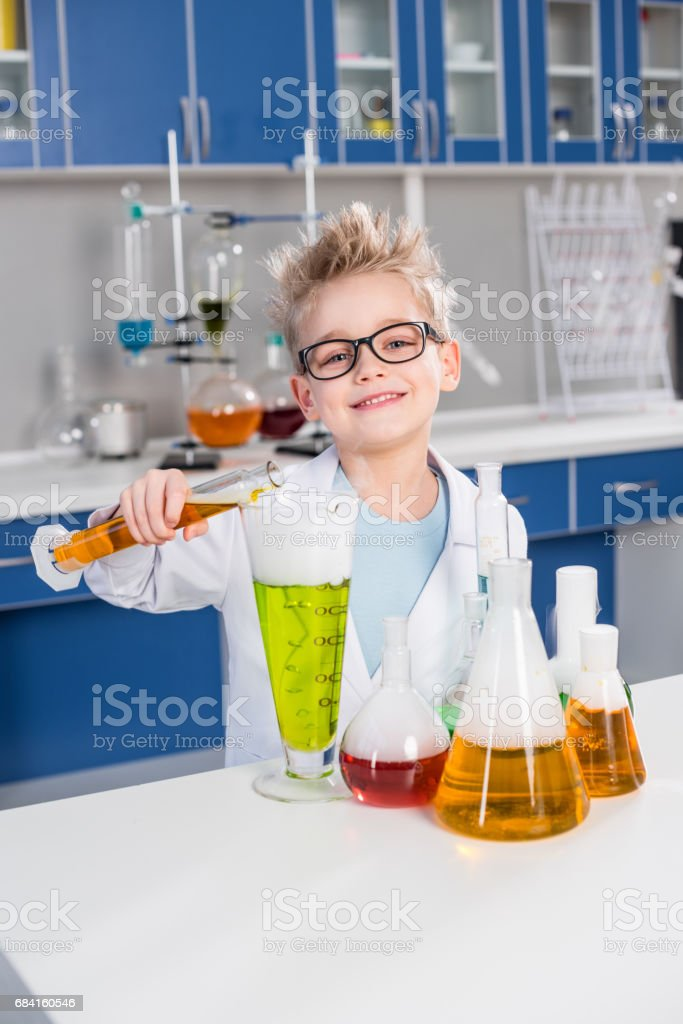 Boy making experiment royalty-free stock photo
