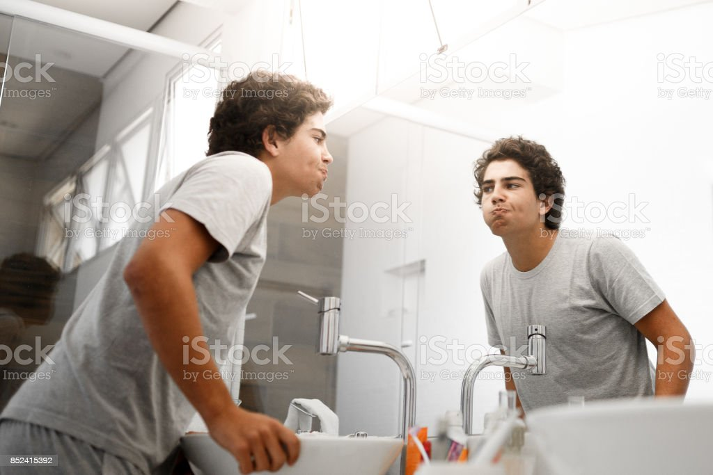 Boy making mouthwash in the morning stock photo