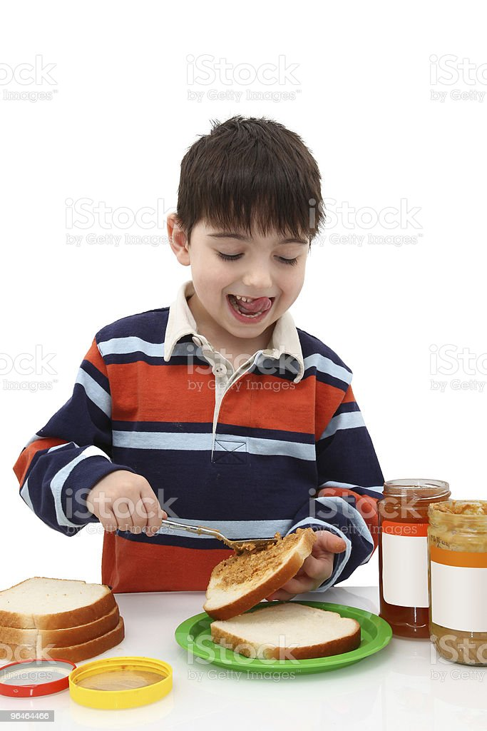 boy making peanut butter and jelly royalty-free stock photo