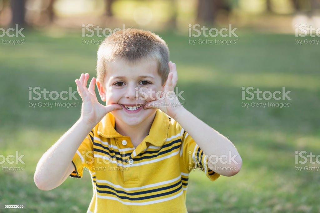 Boy making playful face at camera foto stock royalty-free